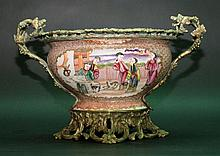 Chinese porcelain bowl with bronze mount, oval form with richly decorated bronze base, handgrips and