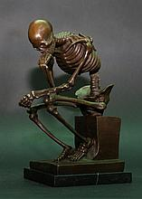 The thinker skeleton, in sitting position with arms rested on the left knee supporting the head, on