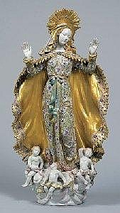 Maria Immaculata, supported by clouds, 3 angels at her feet, Eugenio Pattarino, Florence, circa 1940/60, ceramic ware, polychromed and gilded, height: 75,5 cm, reverse of the plinth inscribed Prof. E. Pattarino, Italy, 3 fingers pasted, (Hr) Folk Art