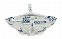 A Worcester blue and white two-handled sauceboat, circa 1758, painted with the
