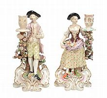 A pair of Minton porcelain figural candlesticks, mid 19th century