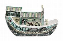 A Famille Vert Model of a Riverboat, decorated on the biscuit in typical...