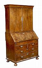 A George II walnut bureau bookcase, circa 1740, moulded top