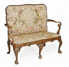 A walnut sofa, in George I style, 19th century