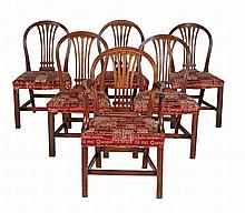 A set of twelve mahogany dining chairs, to include a pair of armchairs