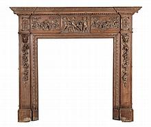 A carved pine chimney piece in George III style, late 19th/early 20th century