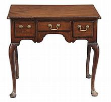 A George II walnut lowboy, circa 1750, the moulded top with three short...