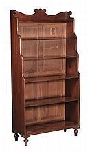 A Regency mahogany waterfall bookcase, circa 1820