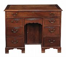 A George II mahogany kneehole desk circa 1740 with a rectangular top