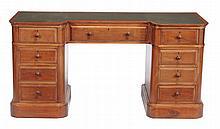 A mahogany inverted breakfront pedestal desk, circa 1900