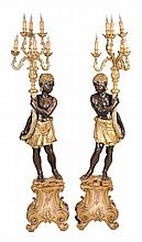 A pair of Venetian style stained and giltwood blackamoor floor standing...