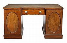 A mahogany desk, circa 1800 and later, the tooled simulated leather inset...