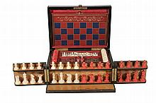A Victorian ebonised and brass strung games compendium, circa 1880