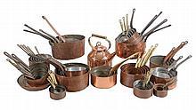 A copper, brass and wrought iron mounted ºtterie de cuisine'