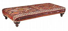 A kilim upholstered day bed, 20th century on ring turned tapering legs 40cm...