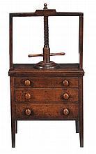 A late George III oak press, circa 1810, with book press to top over three...