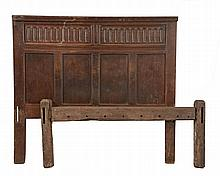 A carved oak bed frame, circa 1660 and later