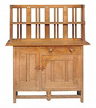 An Arts and Crafts oak sideboard by William Birch, circa 1900