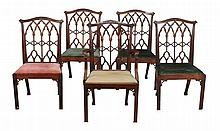 A set of four dining chairs in George III style, late 19th /early 20th century