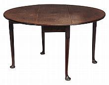 A George II mahogany circular flap top table, circa 1740