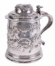 A Charles II silver later embossed tankard, maker's mark GD, a mullet below