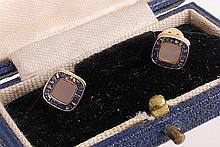 A pair of French sapphire cufflinks, the square panels set with calibre cut...