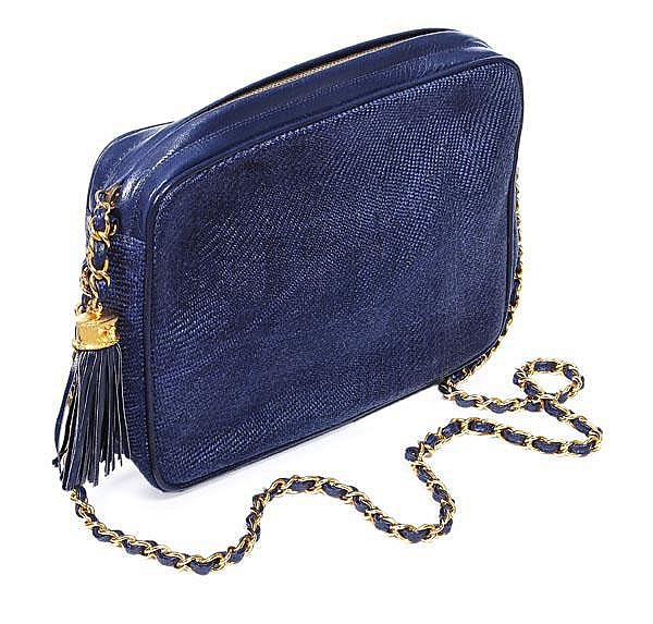 Chanel, a blue woven straw and leather clutch