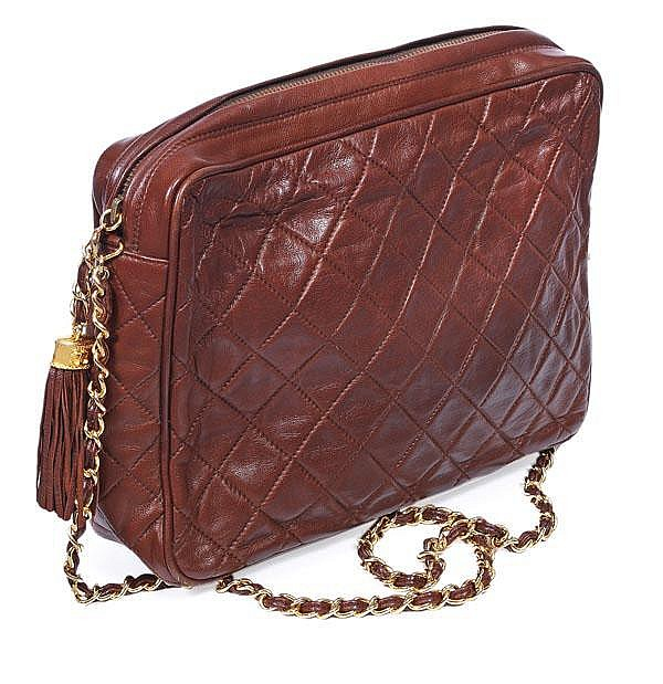 Chanel, a brown quilted leather clutch shape
