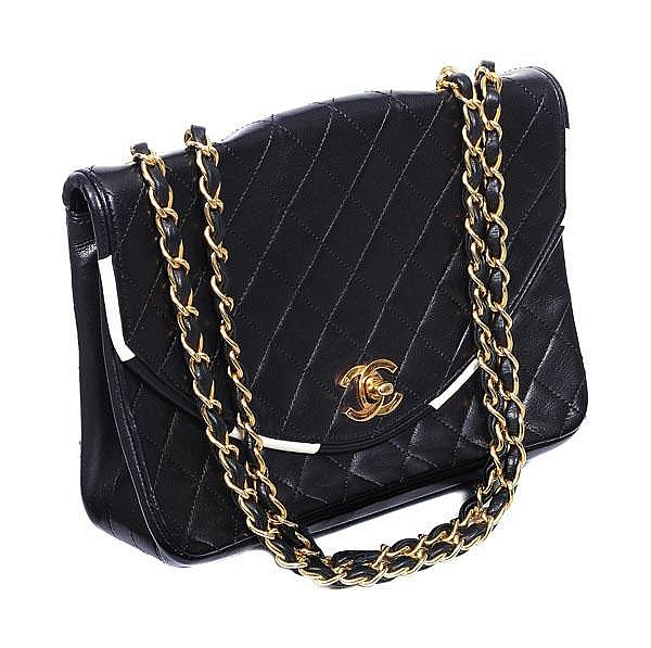 Chanel, a quilted black leather handbag, the D