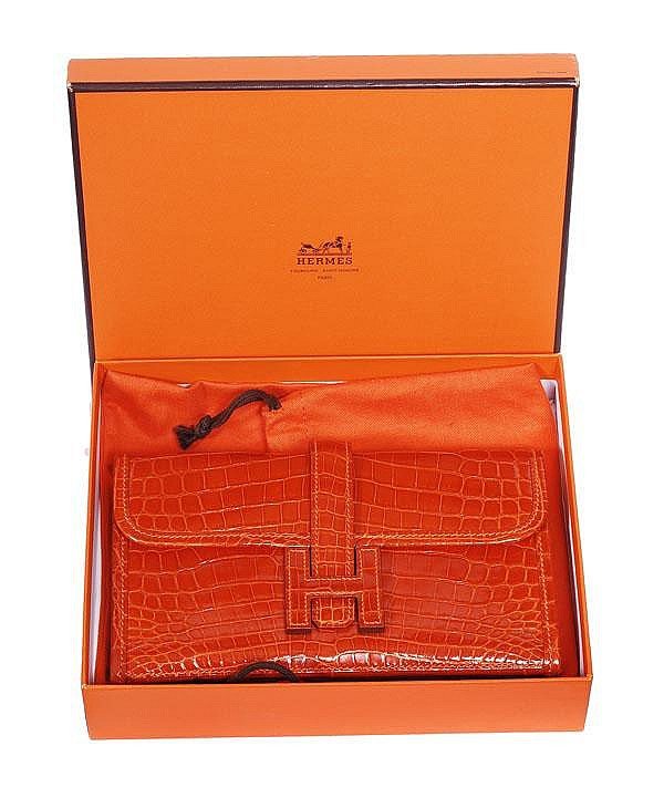 Hermes, an orange crocodile skin Pochette Jige