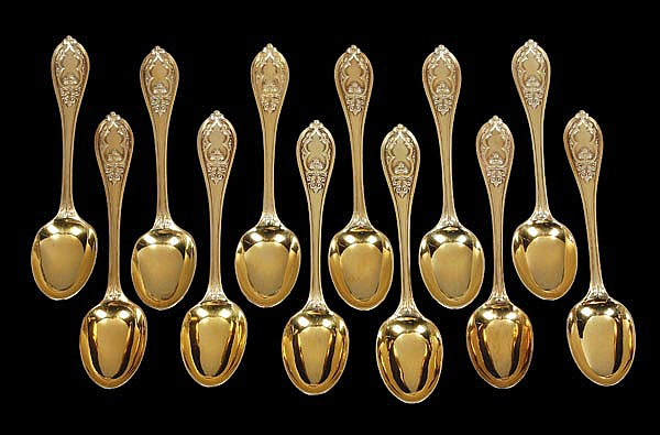 A set of twelve Victorian silver gilt New Gothic