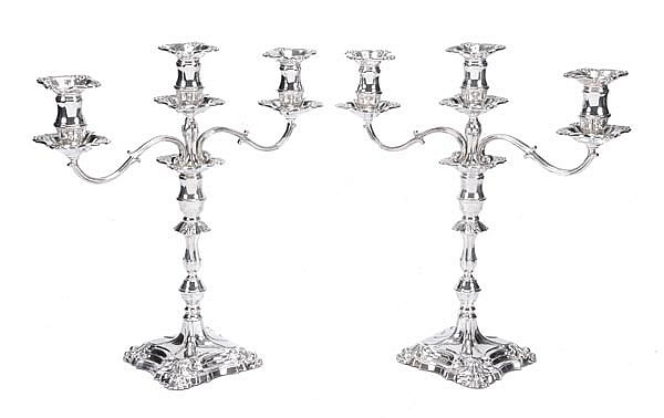 A pair of silver twin branch three light