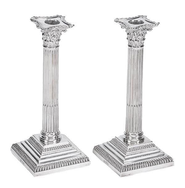 A pair of silver Corinthian column candlesticks by