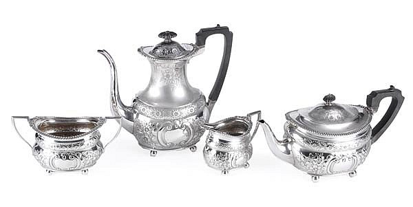 An Edwardian silver four piece oblong baluster tea