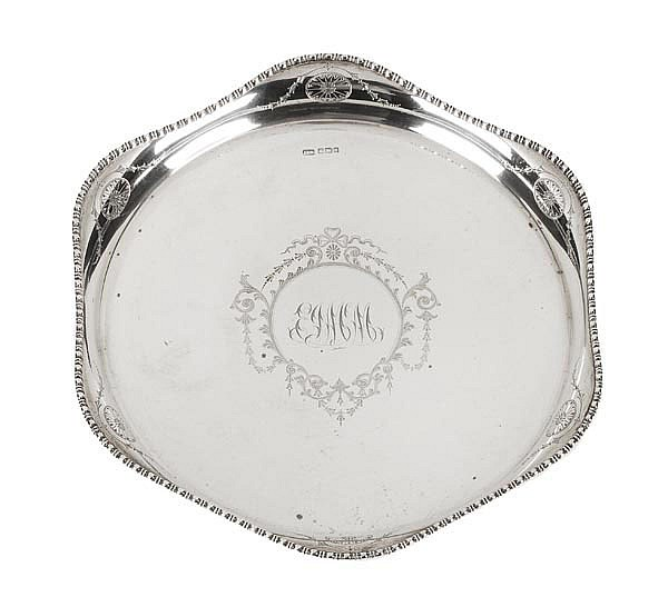 An Edwardian silver shaped circular drinks tray by
