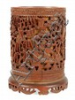 A Chinese bamboo brush pot with integral stand,