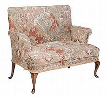 A mahogany settee in the Queen Anne style early 20th century  A mahogany settee in the Queen Anne style   early 20th century, the rectangular back with scrolled arm supports, squab cushion on cabriole legs 100cm high, 124cm wide, 61cm deep
