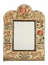 A stumpwork framed dressing table mirror, the needlework early 18th century... A stumpwork framed dressing table mirror, the needlework early 18th century and later, the arch topped surround with animals and insects amongst flowers, around a