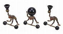 A Continental, almost certainly Austrian cold painted bronze desk set cast... A Continental, almost certainly Austrian cold painted bronze desk set cast with frogs, early 20th century, the spherical inkwell with hinged cover held on the back of of