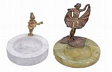 An Austrian cold painted bronze mounted onyx cindrier, early 20th century An Austrian cold painted bronze mounted onyx cindrier, early 20th century, the figural mount cast as an erotic dancer, the skirt hinged and lifting at the front, 13cm high; and