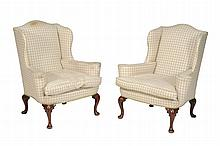A pair of walnut and upholstered wing armchairs in Queen Anne style