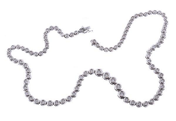 A diamond line necklace, composed of ninety four