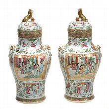 A pair of Chinese famille rose lidded jars, 19th