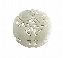 A jade pendant, 19th century, of irregular