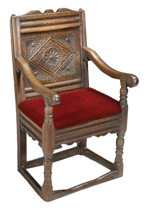 A Charles II oak panel back armchair, circa 1660,