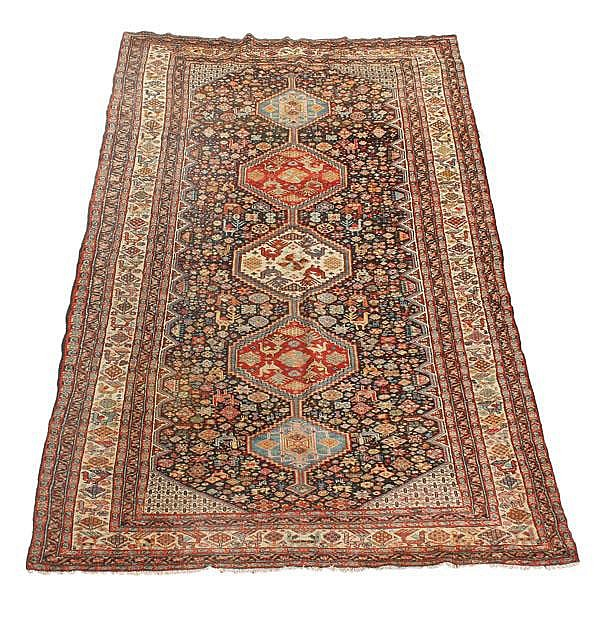 A Shiraz carpet, approximately 326cm x 183cm