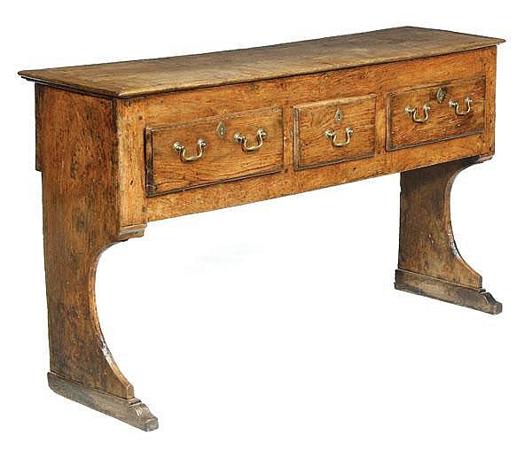 A George II elm and oak dresser base, circa 1750,
