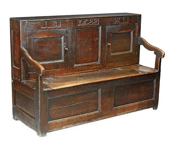 An oak hall settle, 17th century and later, the