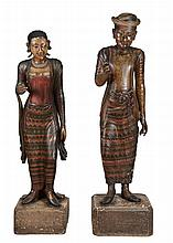 A pair of South East Asian carved and polychrome paintman and painted wood...