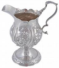 A George III silver baluster cream jug by Robert